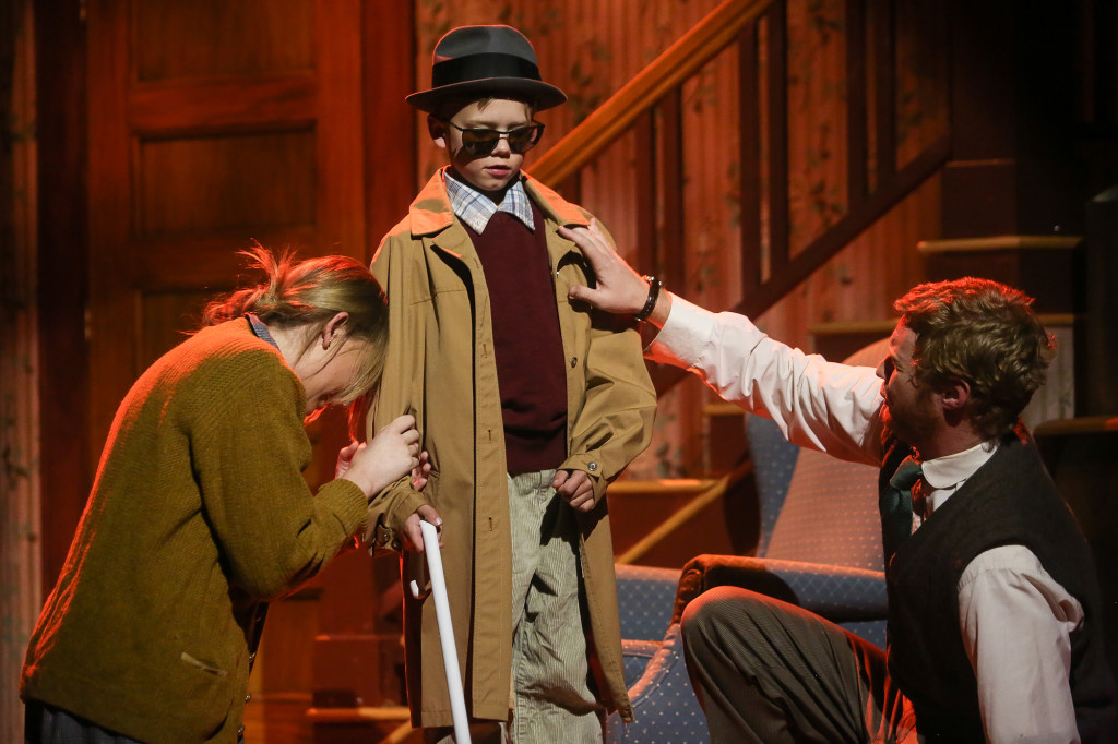 Ralphie, played by Nate Wozniak, is blind in a daydream as his dad, junior theatre major Tim Werth, and   mom, freshman theatre major Annie Booth, wheep to him. A Christmas Story opens tonight at the University Center for the Arts and will run Thursday through Sunday until December 15.